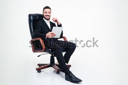 çekici ofis koltuğu cep telefonu tam uzunlukta sakallı Stok fotoğraf © deandrobot