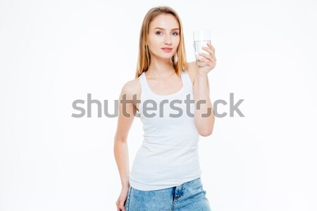 Charming woman holding glass with water Stock photo © deandrobot