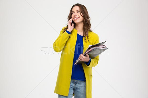 Felice donna cartelle parlando cellulare Foto d'archivio © deandrobot