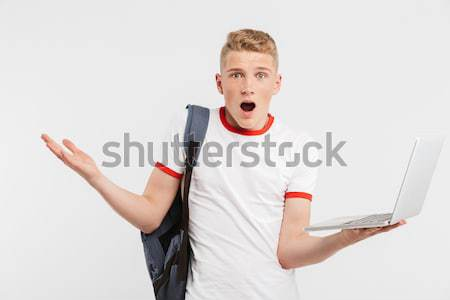Angry irritated young business woman holding mobile phone  and shouting  Stock photo © deandrobot