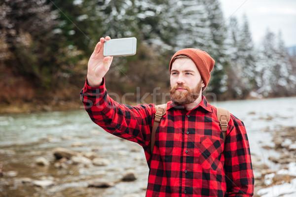 男性 ハイカー 写真 スマートフォン 屋外 ストックフォト © deandrobot