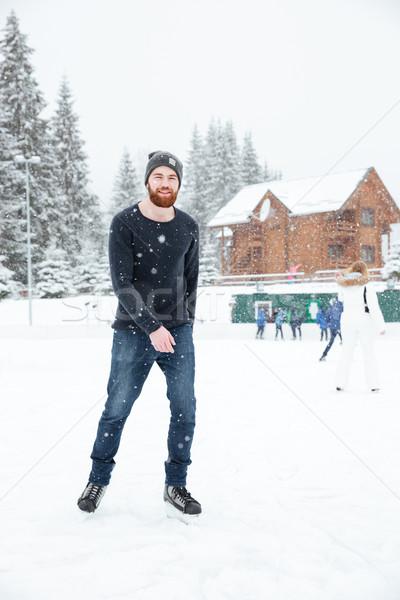 Felice uomo ghiaccio pattini esterna Foto d'archivio © deandrobot