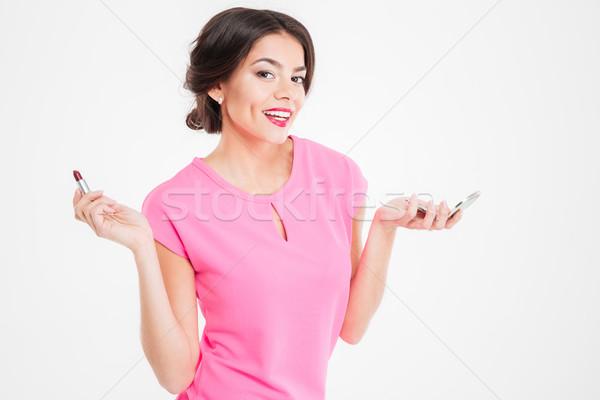 幸せ 美しい 若い女性 ミラー 口紅 ストックフォト © deandrobot