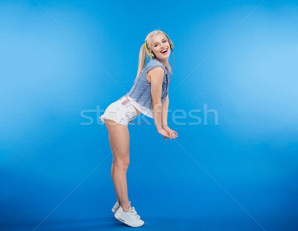 Full length portrait of a happy stylish woman  Stock photo © deandrobot