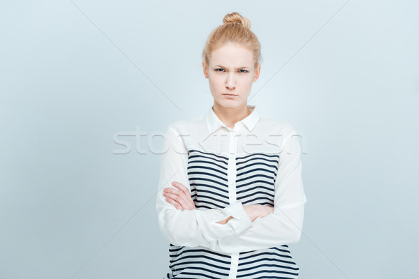 Angry woman with arms folded Stock photo © deandrobot