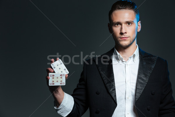 серьезный молодым человеком маг Постоянный два Сток-фото © deandrobot