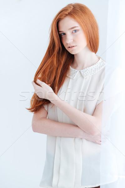 Potrait of a pretty redhead woman Stock photo © deandrobot