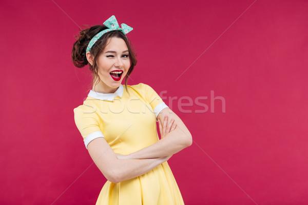 Szczęśliwy atrakcyjny pinup dziewczyna żółty sukienka Zdjęcia stock © deandrobot