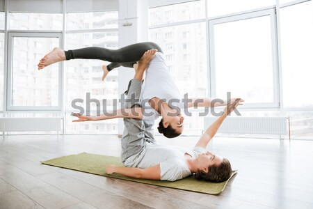 Souriant acrobatique yoga poste studio Photo stock © deandrobot
