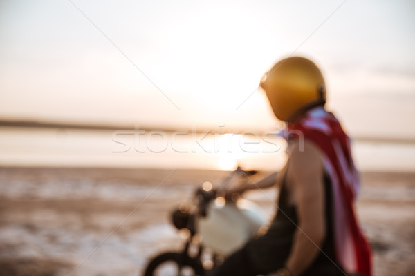 Unfocused image of man in american cape sitting on motorcycle Stock photo © deandrobot
