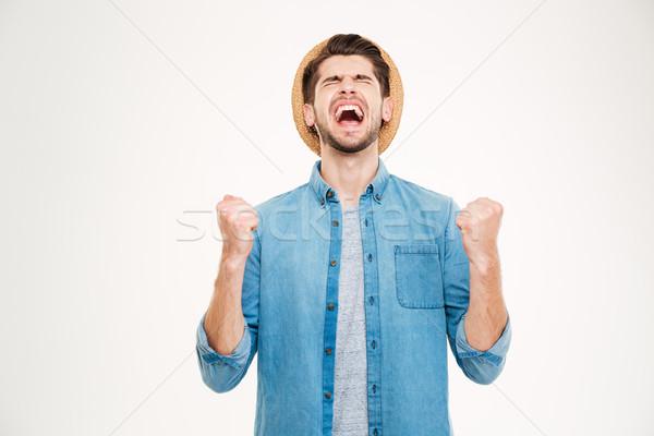 Bonito casual homem excitação isolado Foto stock © deandrobot