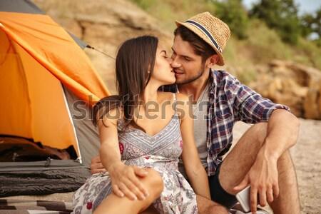 Gyönyörű pár ül sátor csók közelkép Stock fotó © deandrobot