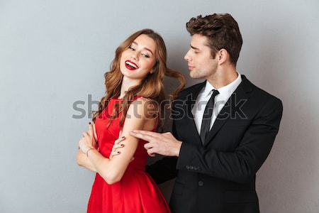 Sensual young couple playing and posing with gun Stock photo © deandrobot