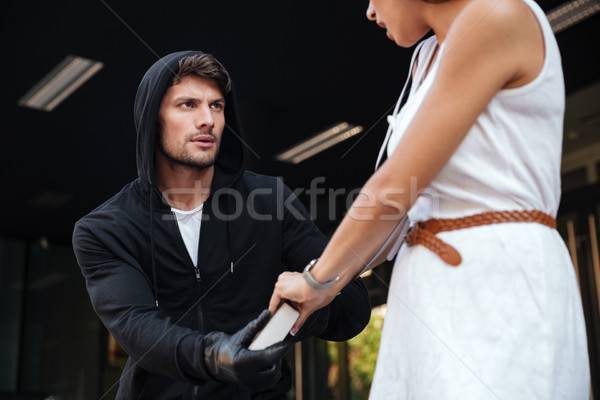 Man robber in hoodie stealing woman bag Stock photo © deandrobot
