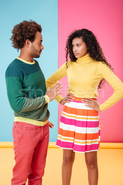 Beautiful african american young couple standing and arguing Stock photo © deandrobot