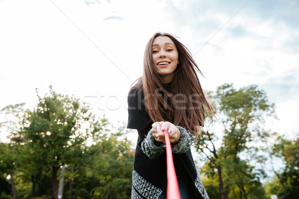 Cheerful pretty young woman with dog on leash Stock photo © deandrobot