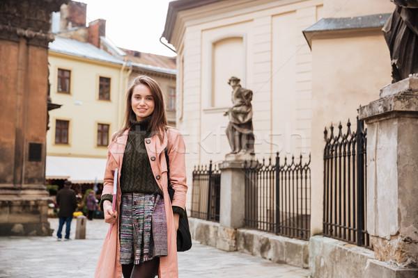 Beautiful brunette in coat Stock photo © deandrobot