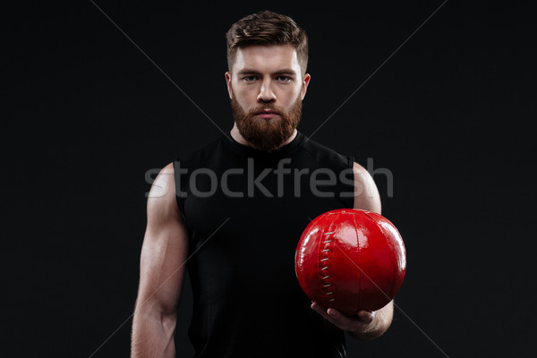 Trainer with ball in hand Stock photo © deandrobot