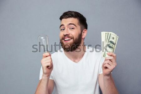 Kép mosolyog lezser férfi tart óvszer Stock fotó © deandrobot
