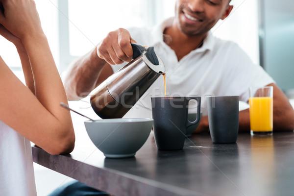 Férfi áramló kávé csészék reggeli barátnő Stock fotó © deandrobot