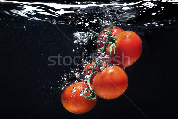High speed photography tomato splash in water Stock photo © deandrobot