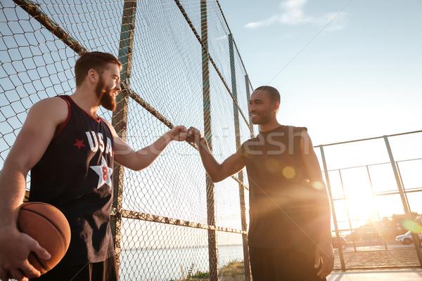 Kettő boldog ököl kosárlabda játék játszótér Stock fotó © deandrobot
