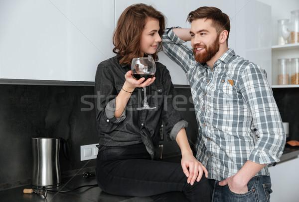 Boldog szerető pár iszik alkohol kép Stock fotó © deandrobot