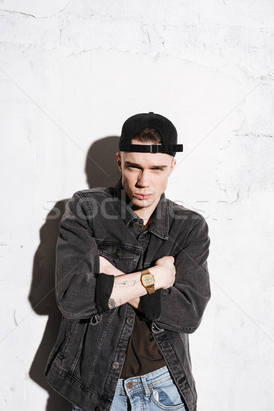 Vertical image of cool hipster in snap back Stock photo © deandrobot