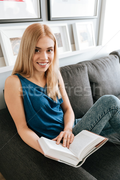 Mutlu çekici genç okuma kitap ev Stok fotoğraf © deandrobot