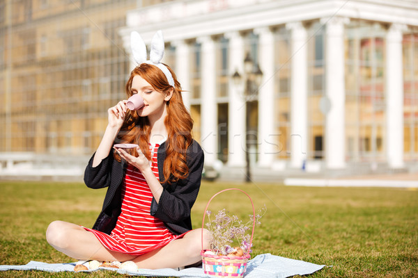 Portrait of a red head girl holding cup of tea Stock photo © deandrobot