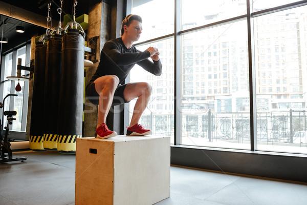 вид сбоку спортивный человека прыжки окна спортзал Сток-фото © deandrobot