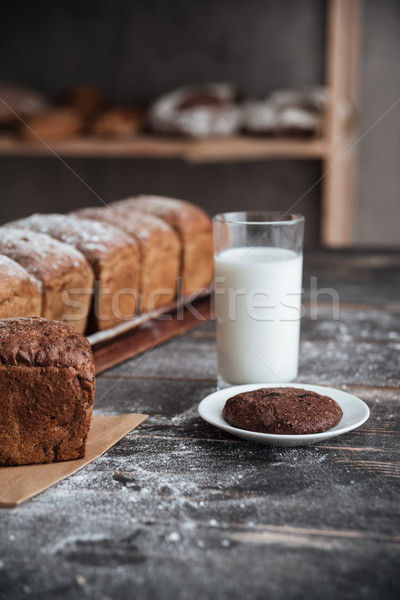 Bread with flour on wooden table with milk and cookie Stock photo © deandrobot