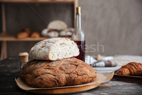 Stock photo: Cropped image of a lot of bread on table