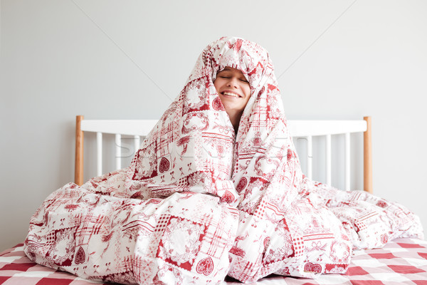 Pretty woman hiding in blanket Stock photo © deandrobot