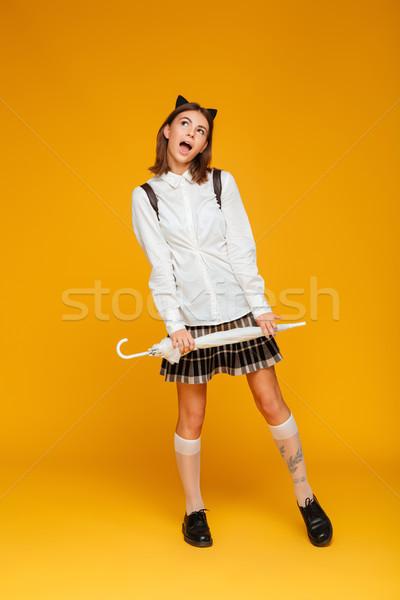 Retrato funny jóvenes colegiala uniforme Foto stock © deandrobot