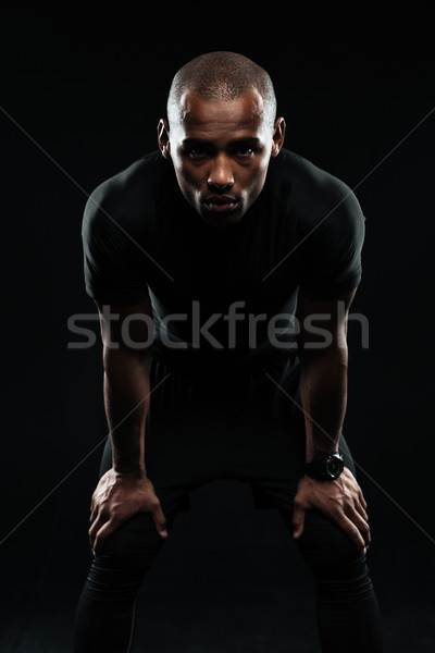 Afro american sports man resting after workout Stock photo © deandrobot