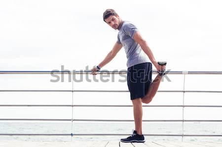 Full length portrait of a strong half naked sportsman running Stock photo © deandrobot