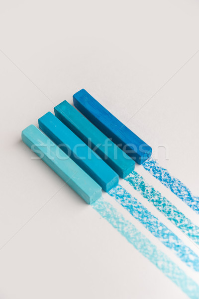 Close up of blue color pastel crayon chalks over its own trace l Stock photo © deandrobot