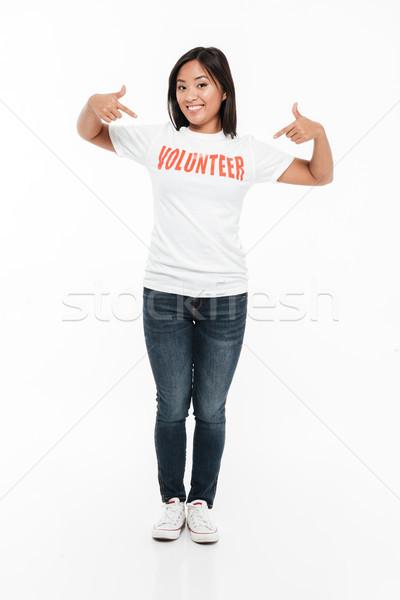 Portret szczęśliwy młodych asian kobieta wolontariusz Zdjęcia stock © deandrobot