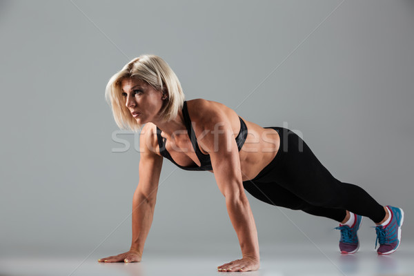 Full length portrait of a motivated muscular adult sportswoman Stock photo © deandrobot