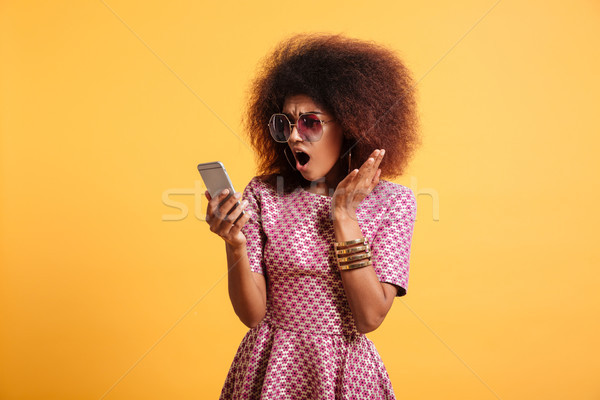 Portrait of a shocked surprised afro american woman Stock photo © deandrobot