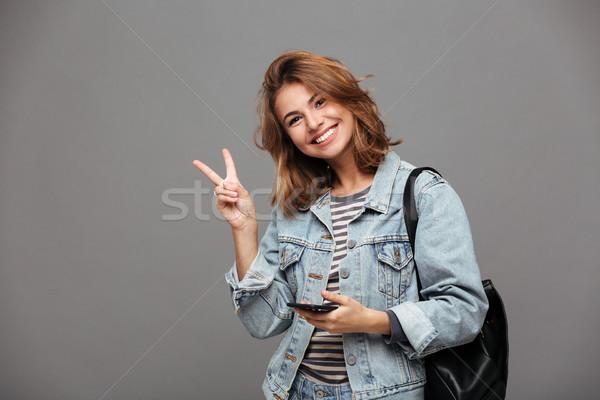 Portret vrolijk jong meisje denim jas rugzak Stockfoto © deandrobot