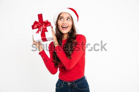 Portrait of a happy wondering asian woman Stock photo © deandrobot
