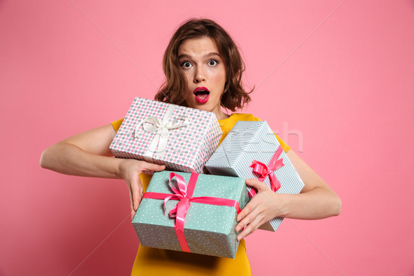 Close-up portrait of amazed beautiful woman holding bunch of pre Stock photo © deandrobot
