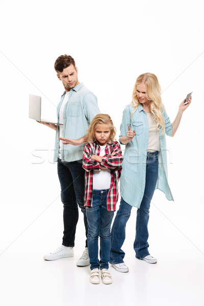 Full length portrait of a busy family having and argument Stock photo © deandrobot