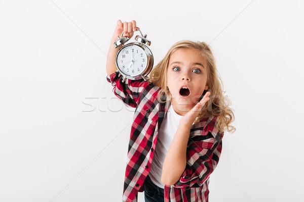 Retrato surpreendido little girl despertador em pé Foto stock © deandrobot