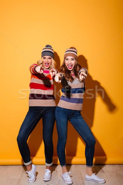 Full length portrait of two cheery girls Stock photo © deandrobot