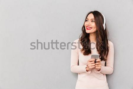 Image of joyous adult girl with retro camera in hands posing in  Stock photo © deandrobot
