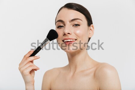 Bright photo of smiling half-naked woman with fresh skin holding Stock photo © deandrobot