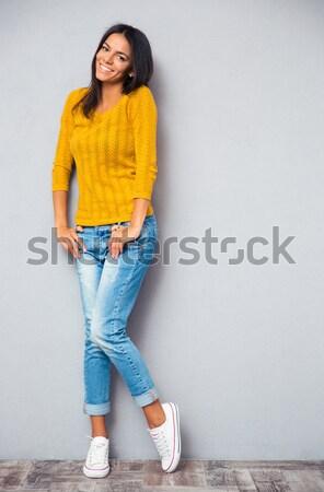 幸せ ブルネット 女性 セーター 座って 階 ストックフォト © deandrobot